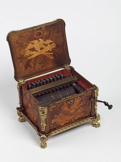 "1770 French Bird organ at the Victoria and Albert Museum, London - From the curators' comments: ""Bird organs were used to teach caged birds to sing different tunes. The user would wind a handle, which pumped the bellows in a wind-box and simultaneously rotated a cylinder, used to control the air-supply to individual organ-pipes and thus produce different tunes. Different types of bird organ were used in France.  This example is a serinette, which copied the sound of finches."""