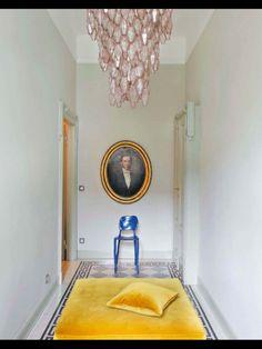 room inspiration - black & white diamond floor, greek key, round portrait, pink chandelier, yellow bench
