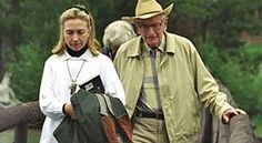 Hillary Clinton interestingly carrying a book on Ufology, while having a quiet meeting with Lawence Rockefeller ( l think).