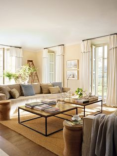 My Paradissi: Farmhouse in Spain Love grouping coffee tables!