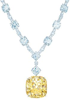 The famous yellow Tiffany diamond in its new setting with the 128.54-carat yellow diamond and white diamonds totaling more than 120 carats.    Via The Jewellery Editor.