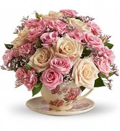Send warm wishes with this lovely gift bouquet that arrives in a ceramic teacup. This charming, old-fashioned bouquet features pink and crème roses.