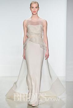 Brides.com: Amsale - Spring 2015. Sleeveless silk organza sheath wedding dress with an illusion high neckline and a draped peplum waist, Amsale