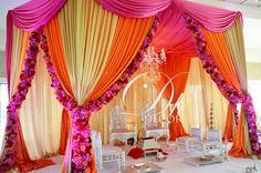 Hot pink and orange mandap