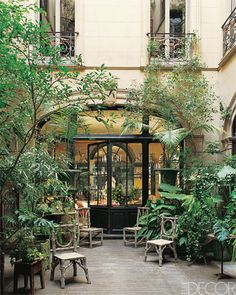 French Patio At an 18th-century row house in the French city of Perpignan, the window grilles and a keystone are emblazoned with the monogram of the onetime owners, the family behind JOB-brand cigarette papers. The courtyard's rustic wood furniture provides a striking contrast to the home's ornate Victorian interior. Read more: Urban Gardens - City Patio - ELLE DECOR