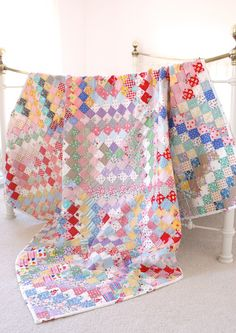 I'm one of those obsessed with the scrappy trips quilts.  Tend to like the softer coloured ones the best.
