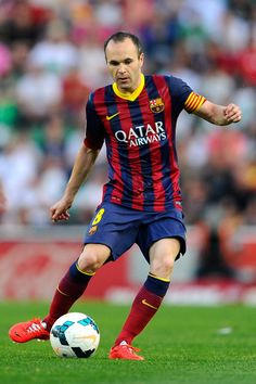 Andres Iniesta of FC Barcelona runs with the ball during the La Liga match between Elche FC and FC Barcelona at Estadio Manuel Martinez Valero on May 11, 2014 in Elche, Spain.