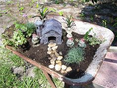 gnome garden, what a great way to use an old wheelbarrow!