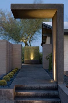 focal point of entry, use of concrete, lighting