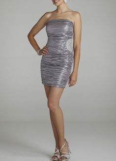 This one of a kind and stunning foil pleated dress is sure to make you center of attention at any special event!  Eye-catching side beaded detail gives this dress a dramatic and unique touch.  Strapless bodice features all over pleated foil adding dimension and creating a slimming silhouette.  Fully lined. Back zip. Imported polyester. Hand wash cold.