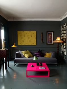 We love this pop of chairish pink with the coffee table. Dark Living Rooms, High Ceiling Living Room, Color Interior, Colorful Interior Design, Interior Walls, Colorful Interiors, Living Room Interior, Home Living Room, Modern Interiors