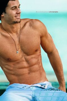Honestly, I don't even know who this guy is. Who cares? Look at those abs!