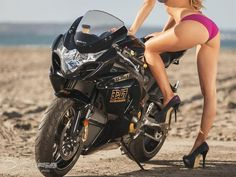 January 2014 Motorcycle Girl Laurie posing with the 2014 Suzuki GSX-R1000 Yoshimura Limited Edition.
