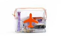 In this Travel kit:  Portable phone charger, toothbrush, toothpaste, lip balm, hair tie, Kirby grip, earring backs, anti-bacterial wipes, nail polish removal pad, plaster, safety pin, tampon, tweezers, emery board, nail stick, mending kit, hairbrush