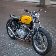 Some motorcycles seem to have a death wish. This funky Yamaha XS400 tracker has survived two major crashes so far, but looks better with every rebuild.