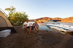 Lake Havasu, AZ on AZ and CA border - boat in camping - BLM manages 87 shoreline campsites along the Arizona side from Lake Havasu City south to the Parker Dam. Site fees are $10/day use or $20/overnight for up to 6 people, $2 per additional person. Overnight fee paid is good until 9am the following day. Most sites have a picnic table, shade cover, barbeque grill, pit toilet, and trash can