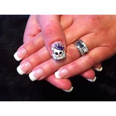 Superfun girly skull i designed myself that my nail tech hand painted on my thumb nail ~ she is an amazing artist!