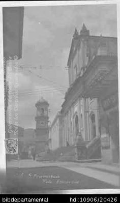 Costado de la Plazoleta de San Francisco. Cali. C.1925.FORO ESCARRIA. Costado de la Plazoleta de San Francisco y 100392. SANTIAGO DE CALI: Biblioteca Departamental Jorge Garces Borrero, 1925. 13X8.