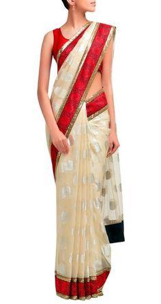 Sabyasachi's Offwhite polka dot sari with matha patti border