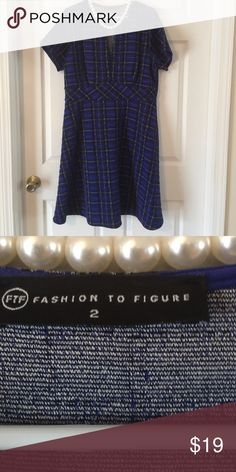 Darling dress with short sleeves Fashion to Figure size 2 made of ply, rayon and spandex. Nice stretch with a waist, short sleeves and a spilt neckline. Dress measures approx 38 1/2 from center back to hem.   Colors are a tasteful royal, black, cream plaid. Just too long for me. Fashion to Figure Dresses
