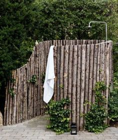 "garden shower |  This would be so easy to make it more private for actually taking a shower.  Awesome naturalized and incorporated into ""cabin"" life.  I probably would use river rocks instead of pavers."