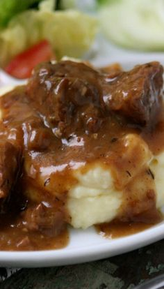 Slow Cooked Tri Tips and Gravy with Mashed Potatoes... Seriously the most tender meat I've ever had! And those potatoes are just swimming in creamy gravy!
