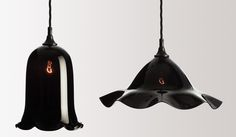 An opulent range in black glass made using traditional freeblown techniques to create elegant fluid forms with a rich, reflective quality. £340.00 RRP