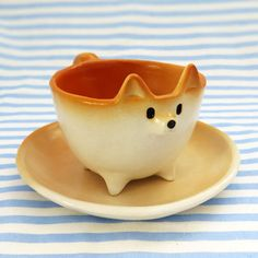 """culturenlifestyle: """"Adorable Ceramic Figurines by Tetsuya Iseda Japan-based artist Tetsuya Iseda's passion for the dog breed Shiba Inu (a popular Japanese dog) extends to his ceramic sculptures and. Ceramic Cups, Ceramic Pottery, Ceramic Art, Clay Projects, Clay Crafts, Animal Mugs, Cute Cups, Ceramic Animals, Clay Pots"""