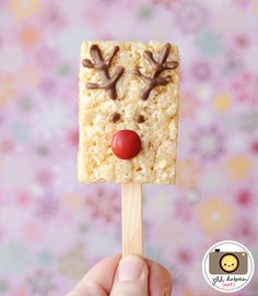 Love this idea for a Christmas reindeer themed snack on a stick! So simple yet so cute! Start saving up all those red Smarties!