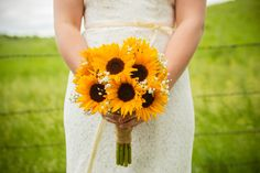 Simple lace dress with ribbon detail. Boquet of sunflowers and baby's breath. Kira + Kevin 's Wedding Photo By Allison Wonderland Photographie