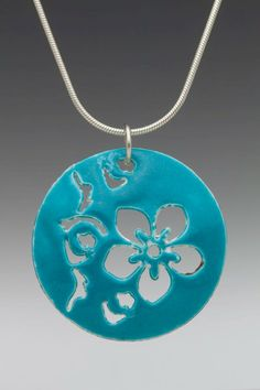 "Domed Round Enameled Cherry Blossom Necklace. The necklace is made of sterling silver, domed, enameled, round disks which are 1"" in diameter. They are pierced with a design of cherry blossoms and enameled. The chain is also made of sterling silver."