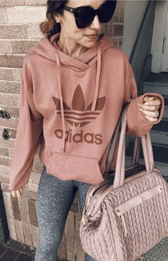 #fall #outfits women's brown Adidas pullover hooded jacket, gray pants, black sunglasses, with pink handbag outfit. Click To Shop This Look.