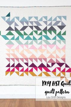 Modern HST quilt design. Showcasing the many different negative and positive shape designs that can be achieved. Pattern by Lou Orth Designs