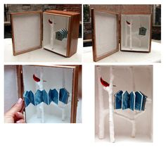 Cardinal Memoirs by Jill McKeown. Assemblage - Accordion format cyanotype book and twigs inside box. 2007.