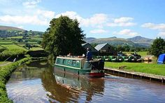 Joyous, informal and unhurried, canals offer a magical escape from the pressures of the modern world. Max Davidson meets the authors of 'Cool Canals', a new book which quietly celebrates this very British way of life. Steady as she goes: the Monmouthshire and Brecon Canal offers peerless Welsh scenery, including the Brecon Beacons shimmering in the distance