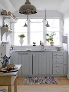 Contemporary Style Small Kitchen Design With Clean And Clear White Kitchen Paint Color And White Mahogany Solid Kitchen Cabinet Plus Wall Mo...