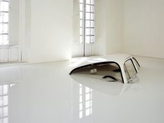 Art Installation - Hasta las Narcices by Ivan Puig from 2004.  It looks as though the car has melted into a room full of milk.  I think it's rather mind-blowing! --Georganna Louise, Art...
