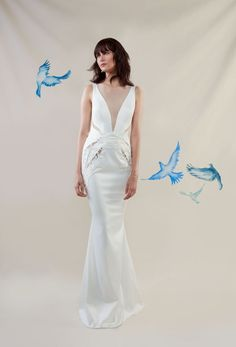 This trend lends an air of sexiness to a wedding dress without overexposure. A deep plunging neckline paired with lace-appliqué-adorned sheer panels is bold and beautiful.