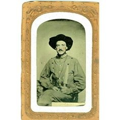 """WESTERN REBEL POSES WITH A GIANT ARKANSAS TOOTHPICK BOWIE KNIFE AND HOLSTERED REVOLVER, Commonly known as a 1/8th plate in brass mat and glass. This superb Rebel poses with an unsheathed upright large bowie knife known as a """"Arkansas Toothpick"""" with a wooden handle. He wears a slouch hat and a V style battle shirt ornamented with buttons. On his right side one can see the handle of a holstered revolver with a lanyard around his neck. The tintype has a southern style paper mat with embossed…"""