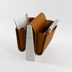 'SADDLE' MAGAZINE RACK BY NOBLE & WOOD – Created by London-based trio Blease, Pourcher and Pelegrin, this piece is elegant enough to renew anyone's love of the printed word. Italian leather pouches straddle a marble or walnut base. £750; £995 in marble (nobleandwood.com).