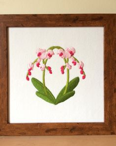 Framed embroidered picture of orchids, by Ruth O'Leary
