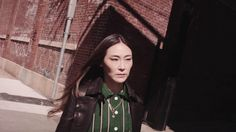 West Coast creative consultant Jayne Min visits our brand new New York flagship on Madison Avenue wearing a green lurex striped top, Sommet bag and boots. Madison Avenue, Raincoat, Walking, Youtube, Friends, Videos, Amigos, Boyfriends
