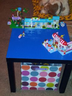 Lego table. $12 table from Walmart. 4 X $5 Lego base plates from Lego.com. <3 it!