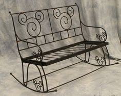 Wrought iron rocking bench with Mickey Mouse desig : Lot 282
