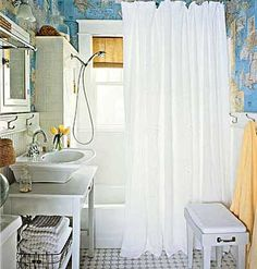 decoupaging maps for wall paper! clever :) love the subway-tile-back-splash in the shower.