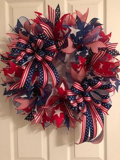 This wreath pops with red white and blue color. Show your patriotic pride on the Fourth of July, Memorial Day, Veterans Day, Presidents Day, Labor Day or anytime of the year. I used red white and blue deco mesh to make this wreath. And accented throughout Patriotic Wreath, Patriotic Crafts, July Crafts, Wreath Crafts, Diy Wreath, Wreath Ideas, White Wreath, Tulle Wreath, Burlap Wreaths