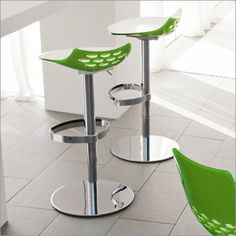 Calligaris Jam Adjustable Swivel Bar Stool ... Contemporary adjustable barstool featuring a bicoloured, curved technopolymer seat - white on the interior, transparent colour on the exterior - with its trademark band of cutaway holes that play with light.For more information call us at 01223 327463 .