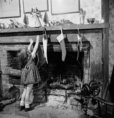 1955The young child is the last of her family to hang a stocking above the family fireplace Vintage Christmas Ornaments, Christmas Stockings, Christmas Photography, Christmas Past, Xmas, London Life, Winter Solstice, Girls Show, Vintage Pictures