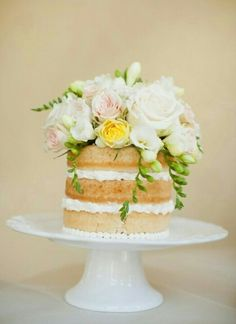unfrosted cake with fondant flowers