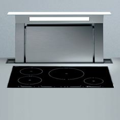 Down Draft by Falmec, motorised extractor integrated in the worktop _
